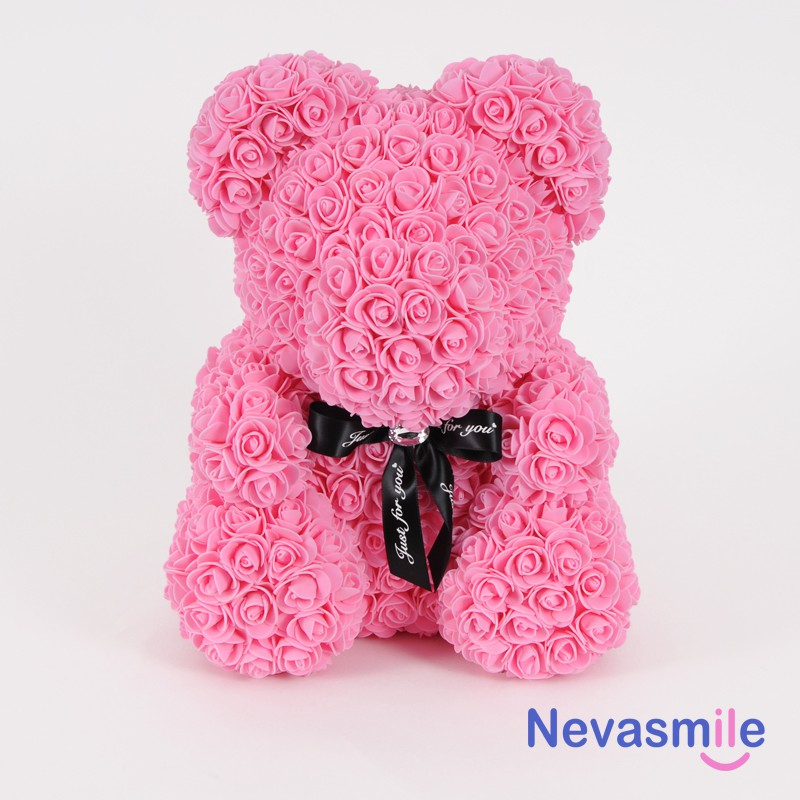 Bear with pink roses